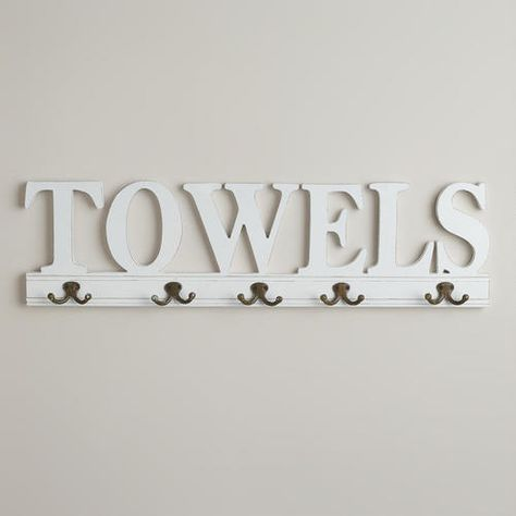 One of my favorite discoveries at WorldMarket.com: 5-Hook 'Towels' Wall Rack - Maybe this instead of a towel rod?
