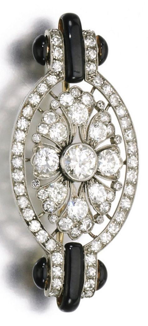 An Art Deco diamond and enamel brooch, 1920s. Millegrain-set with circular- and single-cut diamonds, accented with black enamel, numbered, partial maker's mark, French assay mark.
