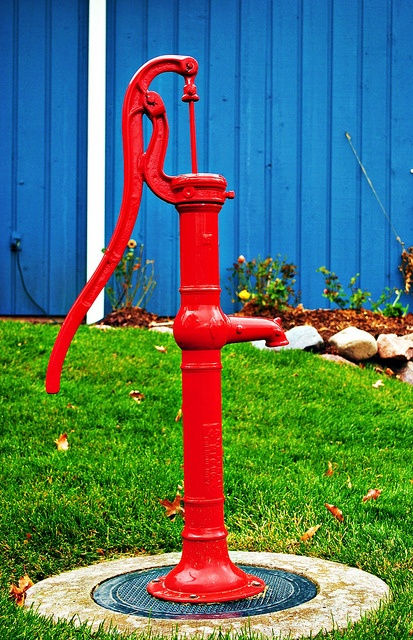 Old red water pump.  I have my grandma's out of her yard.  Putting it in a half-barrel this spring with flowers planted around it.