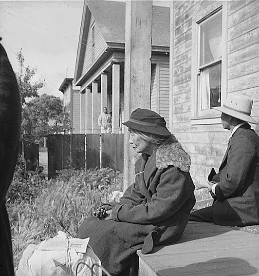 A Japanese-American grandmother waiting to be moved to an internment camp during World War II. Via US National Archives.