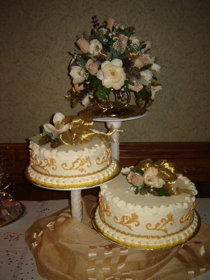 50th anniversary centerpieces | 50th anniversary cake and keepsake floral arrangement. i like the idea