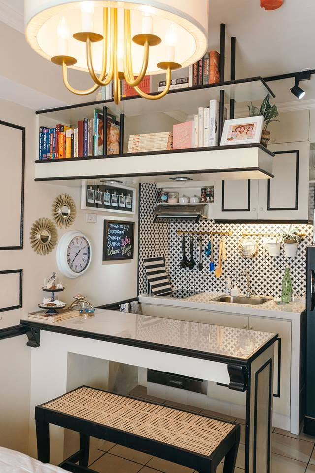 The kitchen exudes an undeniable charm that invites you to cook and prep meals. It features a tile countertop with an extra island that also serves as the dining area. The customized chair is from Betis Crafts and features a solihiya pattern.