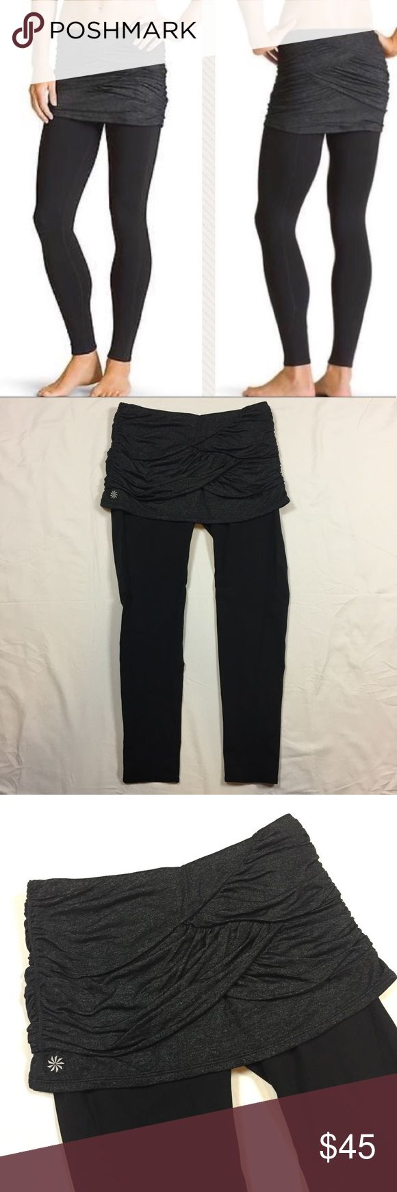 """Athlete Yin Yang Skirted Athletic Pants Stretchy black yoga pants with stretchy, tiered rouched, Pleated gray skirt. Nylon, polyester, spandex blend.  Perfect condition. Style number 930142 Drawstring at waist for secure fit.  One small pocket on butt under the skirt for keys. 3 inches wide, 3.5 inches deep.  26 inch inseam. 11 inch long skirt. Exercise leggings.  Ask any questions about condition or more pictures before you buy. Make an offer using the """"offer"""" button. 15% discount on…"""