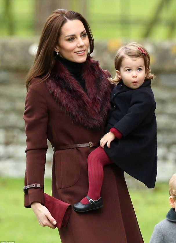 Duchess of Cambridge carries her daughter Charlotte to church service in Buckleberry on December 25, 2016