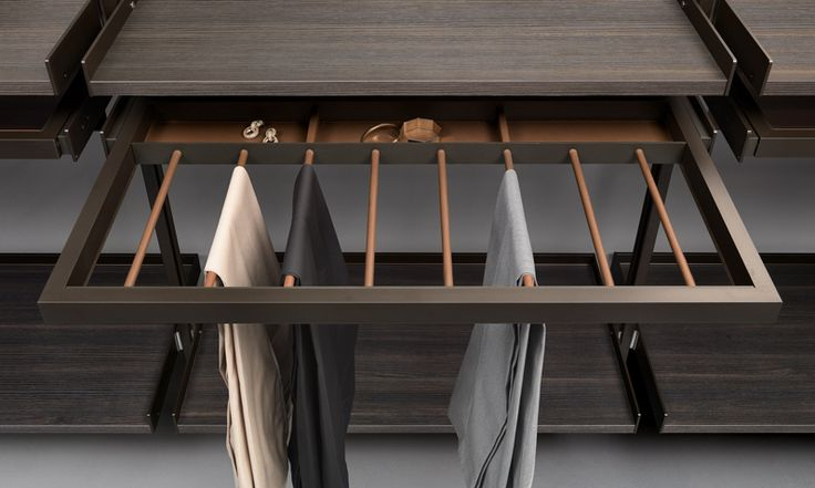 Trousers rack with belts tray in regenerated beaver leather finishing.