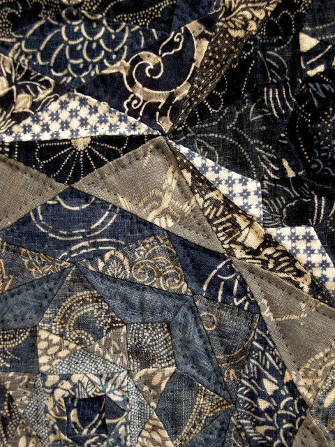 Indigo dyed fabric abound in Japan and in Japanese quilts, often in traditional patchwork blocks like Log cabin, as well as in blocks of original design.  Tokyo International Quilt Festival 2013
