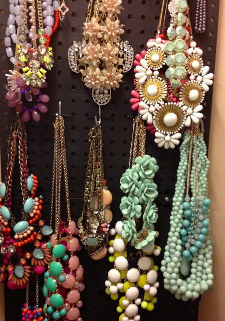 pegboard jewelry organizer - such an easy and pretty way to display jewelry. Could even go on closet wall