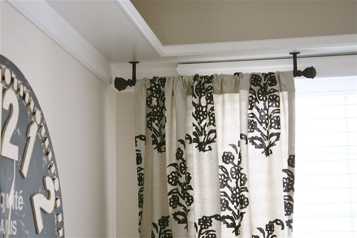 partial rods and visual flow.....effective Partial Black ceiling rod? ceiling drape | The Yellow Cape Cod: Ceiling Mount Drapery Trick
