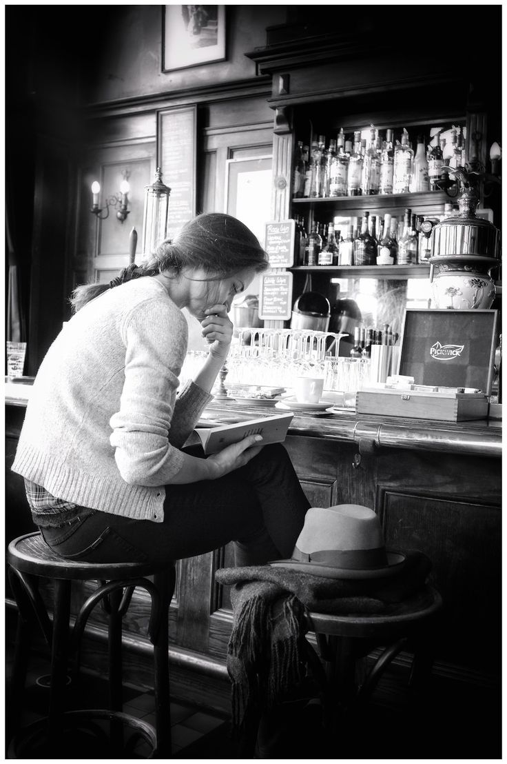 "Reading at bar in Amsterdam. Photograph by Edwin Loekemeijer. ""Street photographer. Wandering around. Always observing. Trying to catch special moments. Seeing, feeling and absorbing the world around me. A passion for photography.:"