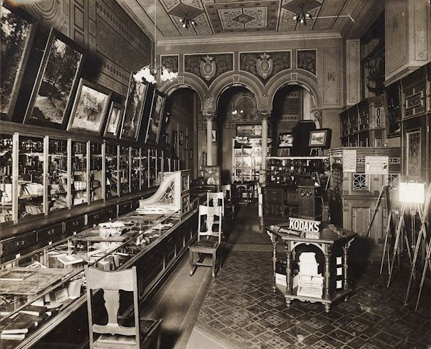 Black and white photograph of a Kodak shop interior, circa 1900. This is likely the Kodak Limited store in the Block Arcade, Collins Street, Melbourne.Photograph - Kodak, Shop Interior