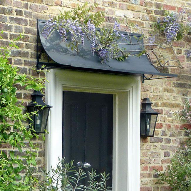 Door canopy in black. Garden Requisites. (Awnings plus door trellises and more.)