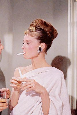 """hepburny: """" Although a smoker in real-life, Breakfast at Tiffany's (1961) is one out of seven films wherein Audrey had to smoke onscreen. She smokes in eight different scenes in Breakfast at..."""