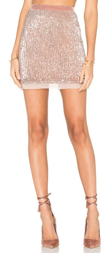 Sequin mesh wild child skirt by Free People. Shell: 100% polyLining: 100% rayon. Hand wash cold. Fully lined. Back hidden zipper closure. Allover sequin fabric wi...