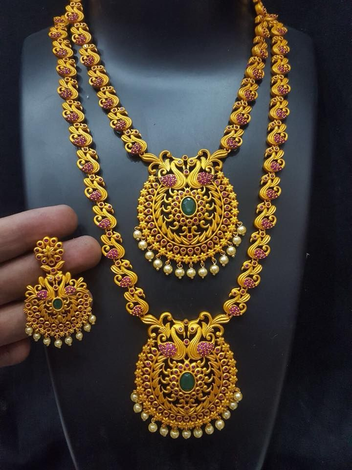 Code HaramNeckless399.Beautiful semi bridal set. Necklace andf long haaram with same pendant. Bridal set with swiming swan design. Necklacestudded with pink color stones.Price 4280 rs free shipping allover india.Whatasp +91 9908278128 to order . 22 December 2017
