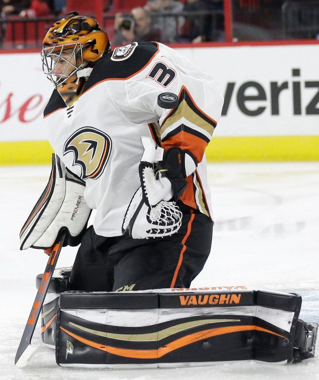 Anaheim Ducks goalie Ryan Miller deflects a shot on goal during the second period of an NHL hockey game against the Carolina Hurricanes in Raleigh, N.C., Sunday, Oct. 29, 2017. (AP Photo/Gerry Broome)