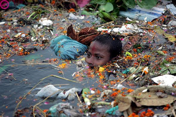Child swims in plastic-saturated waters. This will be all of us if you don't wake up. | #paradigmshift