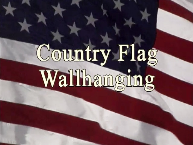 Country Flag Wallhanging Video Tutorial by Quilt in a Day. Join Eleanor waving the red, white and blue with this patriotic flag wallhanging. Honor our country with extra touches of an embroidered eagle and patriotic slogans. Celebrate as a Fourth of July parade winds its way through the streets of Julian, California.