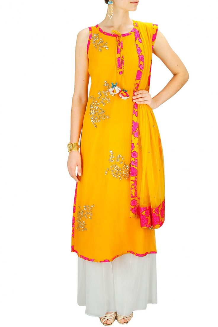 Featuring a yellow chiffon straight suit embroidered with gold sequins motifs in flower pattern and floral lace border detailing. It has tassels attached with f