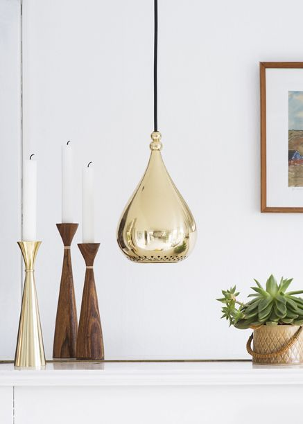 Draapen lamp and Lyda candleholder in solid brass, with Lydia candleholders in North Indian teak wood