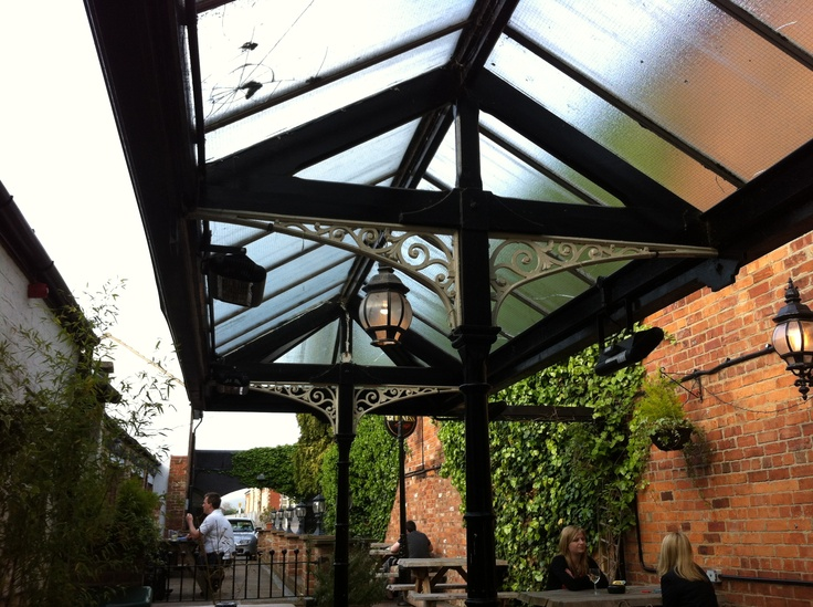 perfect outdoor space! hanging baskets, old fashioned lanterns, heating lamps and IVY!. The Swan, Cheltenham