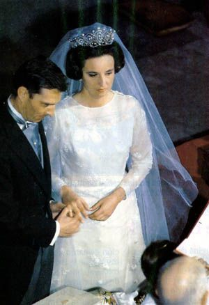 Infanta Pilar and groom Don Luis Gomez-Acebo y Duque de Estrada exchanging vows on their wedding day 5 May 1967. Despite his elaborate name Don Luis was a commoner and Pilar had to renounce her succession rights to the throne to marry him.