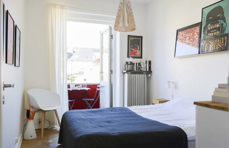 There's a small chair tucked into the corner. Don't underestimate the importance of having at least one chair in your bedroom. It's perfect for putting on shoes and gives your guests a place to sit other than on your bed.