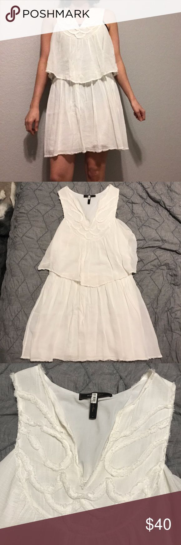 BCBG MaxAzria Gauze Dress Gauze tiered dress. This is pre-owned and has been dry cleaned. No stains, This is super cute for a summer beach vacation. BCBGMaxAzria Dresses