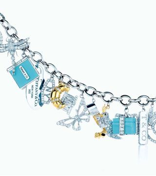 "Tiffany charm bracelet (Vogue.com UK).   For those lucky enough to be able to ignore the credit crunch, this £48,000 charm bracelet is surely the last word in jewellery extravagance. Tiffany's ""ultimate charm bracelet"" features a selection of charms made from yellow gold, platinum and diamonds that embody all of the iconic symbols of Tiffany. That little blue box is there, as is a ""Return to Tiffany"" tag and the famed Atlas clock."