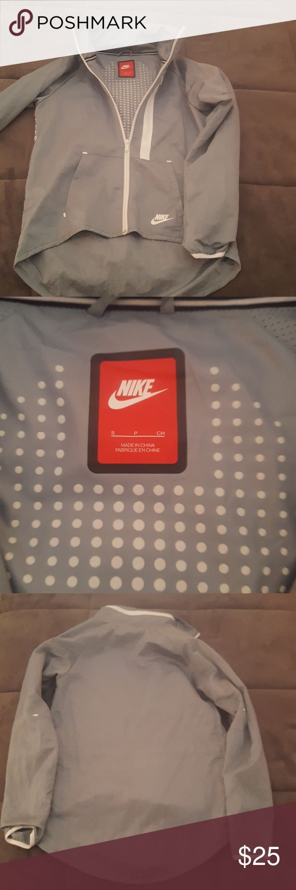 Nike women's running jacket Slim-fitting women's running jacket in size small. Brand new, never worn. Soft Gray with zip out Hood.  Size small. Nike Jackets & Coats Utility Jackets