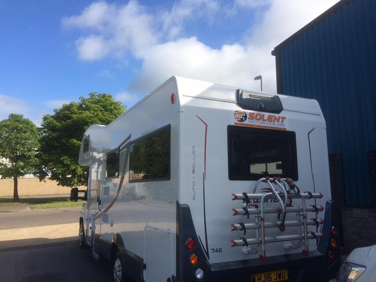 Luxury motorhome with full range of utilities including a fridge, shower and cooking setup - Go Solent motorhome hire