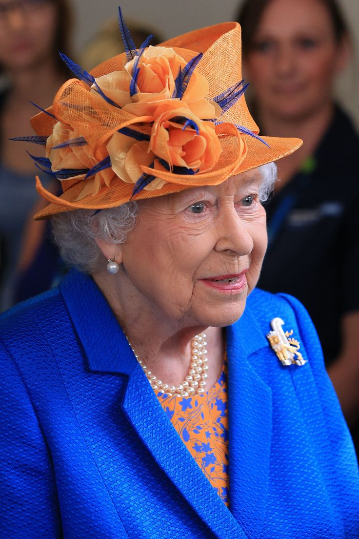Queen Elizabeth arrived at Royal Manchester Children's Hospital shortly after Britain had fallen silent for a minute in tribute to the dead and injured