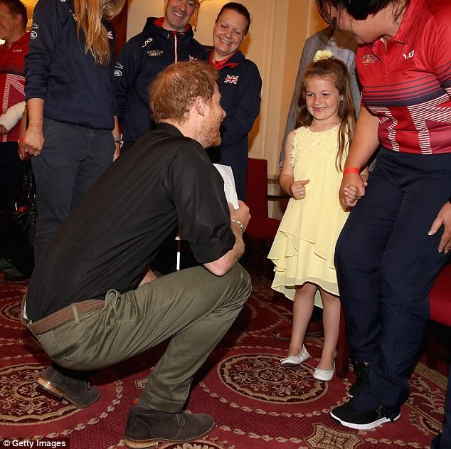 Six-year-old girl Maya Turner smiled shyly as she was introduced to Prince Harry, 32, at an Invictus Games launch event in London today.