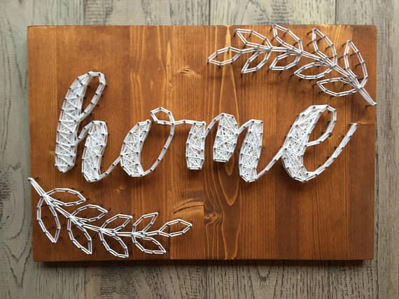 """Made to order, handcrafted """"Home"""" string art wall sign. Constructed on solid pine. Dimensions are approx 15""""x12"""". Pictured is Tuscan stain with bright white string. Other stain options are Chocolate, Weathered Grey, or Antique Aqua. String options are endless! Just let me know what"""