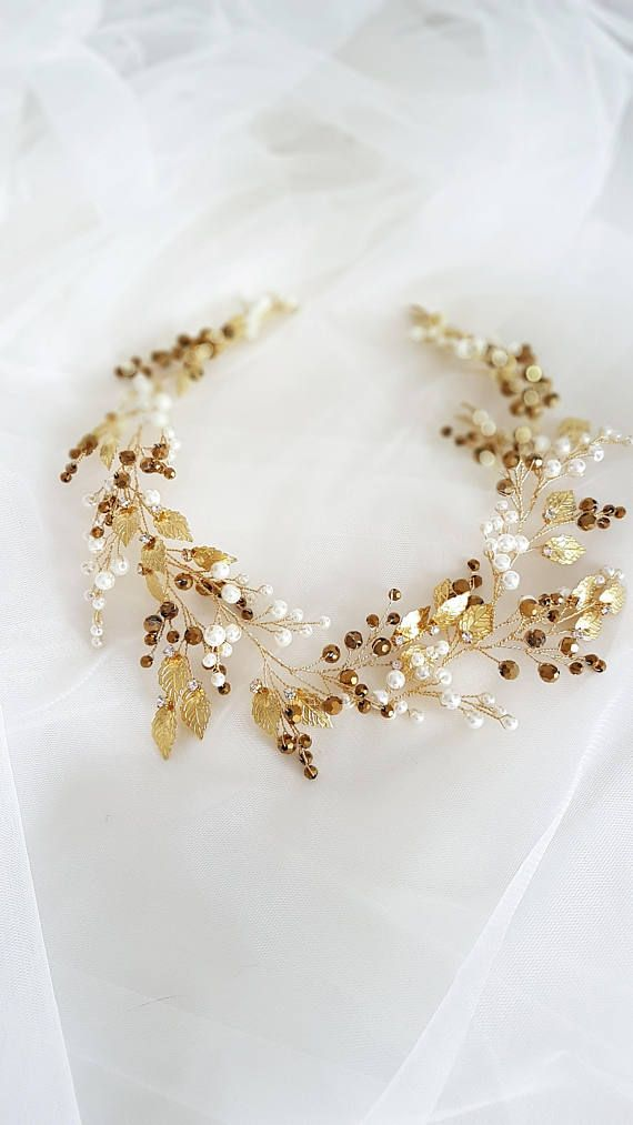 This beautiful handmade bridal wreath made with gold crystal elements, ivory glass pearls and tiny leaves. Complement most wedding hairstyles. It is the perfect bridal headpiece for that woman who wants to simply sparkle on her wedding day. ♥ Size approx 46 сm x 6 сm (18) ♥ Timeless design and suits a range of bridal looks ♥ Flexible and bendable ♥ ATTACHES: secures easily with the bobby pins ♥ The bridal heapiece will be packed in a gift box ♥ Hand made in our studio  NOTE! Processing time…