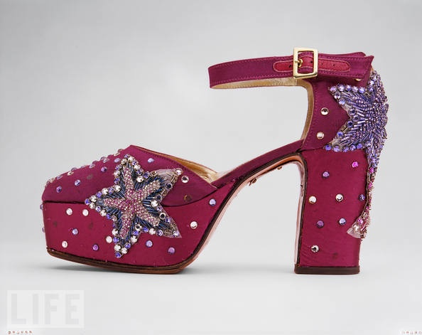 """Madonna: Concert Shoes, 1992 - 1994          Madonna was on her acclaimed Girlie Show World Tour, tied to the release of her fifth studio album, Erotica, when she wore these ankle-strap shoes. The theme of the shows was a """"sex circus,"""" and featured the singer in a variety of costumes designed by Dolce & Gabbana."""