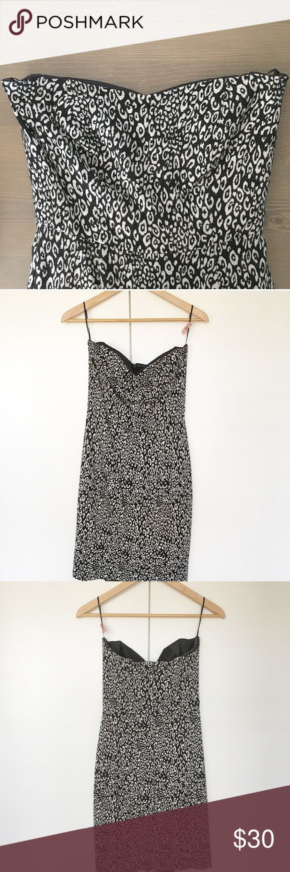 Trina Turk Leopard Print Dress EUC. Worn once. Strapless bodycon dress. Subtle sweetheart neckline. Knee length. Material is comfortable and so soft. Top has built in boning on sides to help maintain shape. Black and white leopard print. Excellent for a night out with your fave strappy heels. Brand is Trina Turk. NOT Zara, used for exposure.  Reasonable offers considered. Please ask questions. 🚫Holds/Trades/Modeling/PayPal🚫 Zara Dresses Strapless