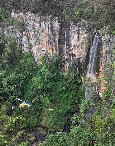 Helicopter delivering parts for the suspension bridge currently being installed at Purlingbrook Falls, Springbrook NP