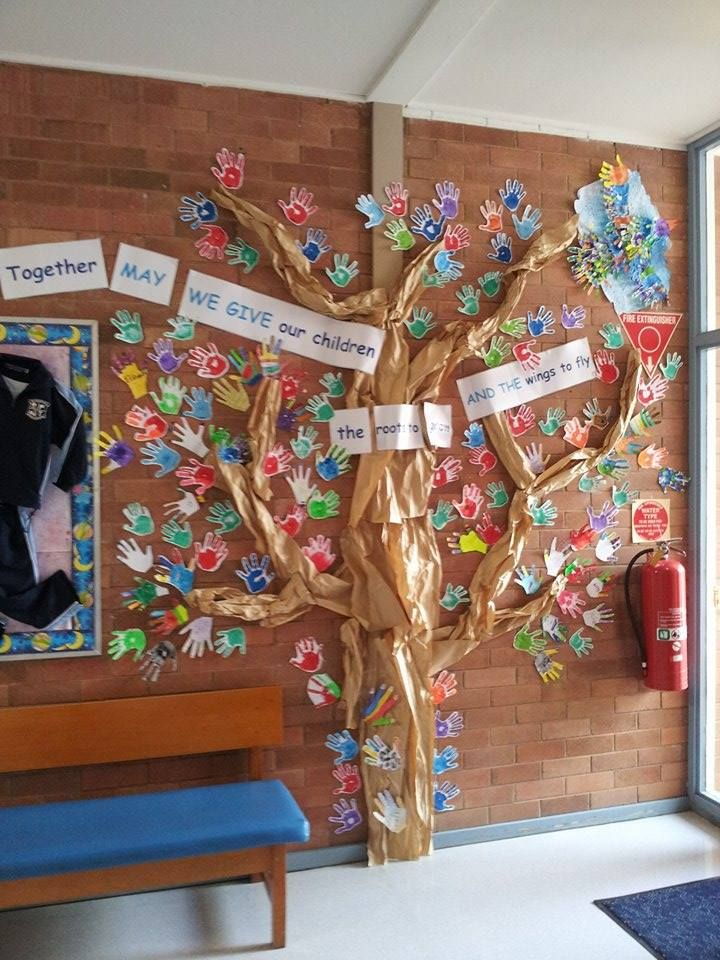 school art display in entrance to school office of students and staff hands at Primary school