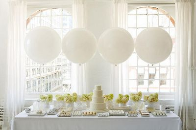 Wedding idea - simple round white balloons and simple green bouquets