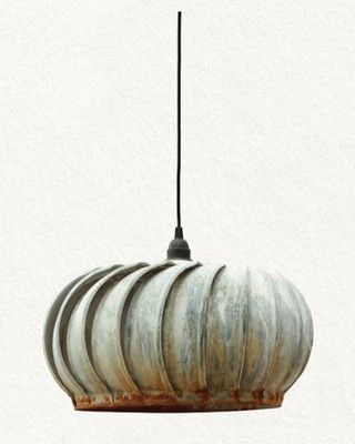 light made from a metal roof vent....would be fun in a garage or shed