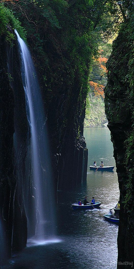 Takachiho Gorge is a V shaped gorge created by the Gokase River which eroded by the Aso  lava. Partway along the gorge is the 17 meter high Minainotaki waterfall cascading down to the river below. Japan