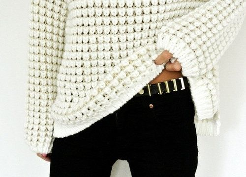 I don't understand people who have a gap that big between their thighs.  It's unnatural.  I like the sweater though.