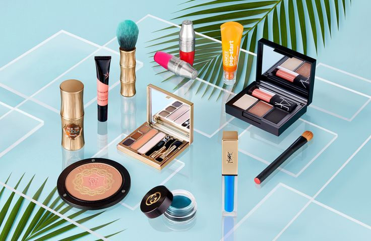 Cosmetics photography shot for World Duty Free. Foundation make up, eyeliner, lipstick, nail varnish, makeup brush, make up powder and makeup palettes. Shot in a still life set design using palm leaves and glass tiles. Photography by London based luxury goods commercial advertising photographer Josh Caudwell.