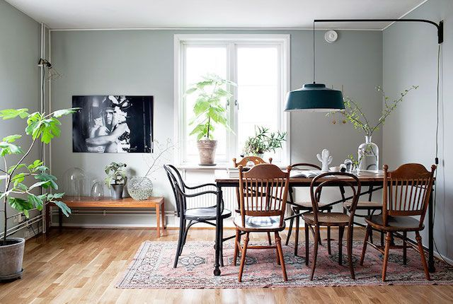 A Swedish apartment with old world charm, such a neat way to put a table together.