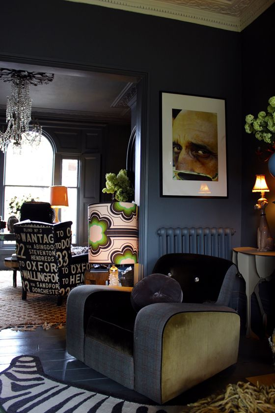 Abigail Ahern home - Love the dark blue and love that awesome chair!