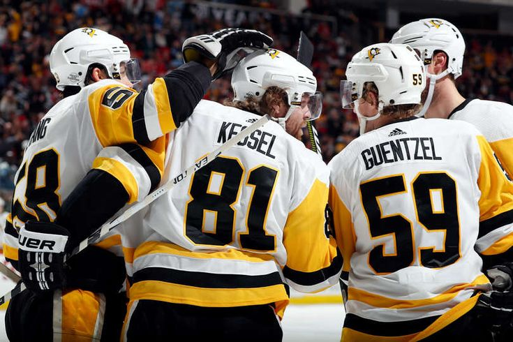 Penguins Mobile: RALEIGH, NC - FEBRUARY 23: Members of the Pittsburgh Penguins congratulate Phil Kessel #81 on his second goal of the second period against the Carolina Hurricanes during an NHL game on February 23 2018 at PNC Arena in Raleigh, North Carolina.  (Photo by Karl DeBlaker/NHLI via Getty Images)