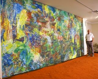 Tim Jennings with Earth's Creation on display at Mbantua Gallery. Aboriginal Art at a record price!