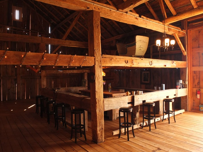 Rustic Bar (beer is served from feed trough full of ice) DJ sets up in hay loft above bar