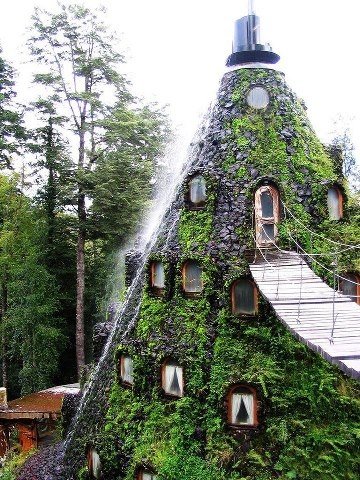 The Magic Mountain Hotel in Southern Chile. Complete with cascading waterfall from the pinnacle of the roof.