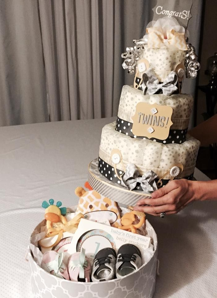 The 3-tiered diaper cake that I fixed atop a hatbox. Lift up the cake and goodies are inside the hatbox. Starzak #Diapercakes #DoitYourself